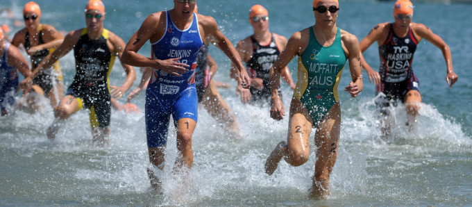 May 10, 2012; San Diego, CA, USA; Helen Jenkins (GBR) and Emma Moffatt (AUS) lead the field out of the water during the 1,500m swim in the womens race in the ITU World Championship Series San Diego at Mission Bay Park. Jenkins won in 1:58.20. Mandatory Credit: Kirby Lee/Image of Sport-US PRESSWIRE